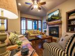 Welcoming Great Room with Custom Fireplace and Flat Screen TV