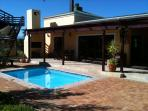 African lodge wrapped around the heated pool