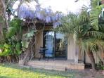 Tropical Getaway With Patio Entrance # 2