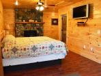Master Bedroom with Fireplace, King bed & 2 person garden tub.  Also with direct access to Hot Tub.