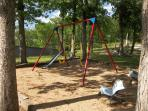 small children's swing set at Robinwood