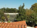 The villa has a private tennis court