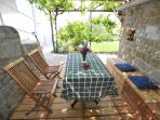 Dine outside in the shade of grapevine