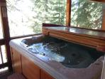 The private hot tub on the back deck will be waiting for you after a day of skiing