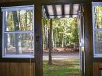 View out the back door into the woods. Deck is now directly out this door