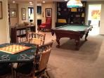 Game Table and Pool Table areas behind sofa area.