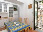 Kitchen with balcony overlooking the square