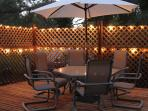 Private patio dining area; spacious deck;  romantic lighting on deck & onto water; BBQ grill access