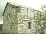 2 storey stone lodge overlooking Galway Bay