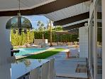 Dine pool side under one of two covered patios!