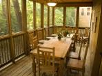 Screened in deck facing wooded area