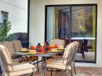 A covered/fanned lanai for alfresco dining.
