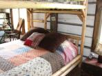 Queen size log bunk beds....very comfortable!  Our guests want to take them home!