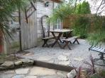 Partial view of the Patio area with picnic table seating and gas grill for your outdoor enjoyment