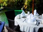 Outdoor dining table by the beautiful pool