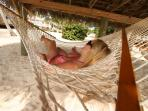 Beachfront hammocks provide a shaded but beautiful place to read or nap