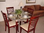 Dinning table with 4 chairs plus 2 chairs at breakfast bar.