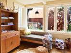 Daybed in the master bedroom suite overlooking sunny back yard.