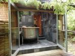 Outdoor/Indoor Wet room with Giant Soaker Tub, Shower and Heated Slate Floor.