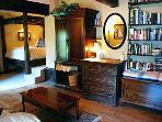 The Stained Glass Room has a sitting area, a fireplace, TV, library and an entrance to a courtyard.