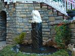 Our back yard water feature. David sculpted the marble angel on top.