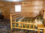 Handmade cedar log furniture, tongue and groove hardwood walls and ceiling all sawn on the farm