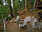 Adirondack chairs to relax amongst the trees