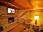 Ledger stacked stone fireplace with flatscreen TV