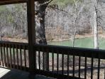 The back porch looks over the lake. There's a gas grill and picnic table.