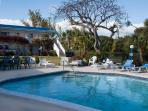 The good-sized pool is surrounded by lovely gardens and the area is well equipped with loungers etc.