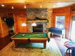 Spacious Game room with pool table and fireplace