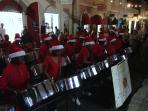 The Rising Stars Steel Pan Orchestra performing during Christmas on Main St.