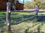 A rustic fences welcomes you to the cozy cabin