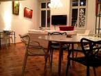 Dinner area with Kartell Masters chairs by Philippe Starck