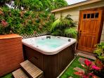 Bubbling Jacuzzi tub perfect for after beach soaking in private rear yard.