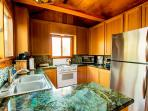 Enjoy custom granite counters and all appliances in this fully equipped kitchen