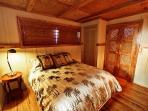 Tommy Bahama inspired bedroom has a queen bed and private in suite bathroom