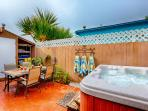 Patio is fenced in with dining area for 4 and hot tub