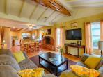 Open floor plan and classic high beamed ceilings, Spanish tile flooring, and paneled walls make this home  a true La...