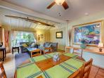 Dining area has a ceiling fan and seating for 6 people