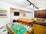 downstairs garage converted into private game room with foosball table, pool table, and 50' flat screen TV