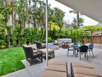 Backyard is lushly landscaped and makes this a private vacation home oasis.