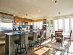 Kitchen is open to dining area with seating for 4 people