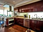Main level (2nd floor) Chef's Kitchen is a chef's dream and fully equipped for all your culinary needs.