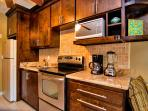 Fully equipped, recently remodeled modern kitchen with granite countertops, and new backsplash tiles     and cabinets.