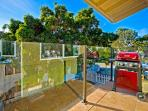 Upstairs outdoor patio off the 2nd floor living area with barbecue and private yard space. Ideal for outdoor fun and...