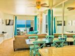 Kitchen is open to dining and living room with more ocean views. Bar-b-que has been removed,