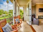 Master suite's deck with inviting wooden chairs for leisure.