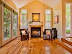 Floor to ceiling windows for natural sun lighting and french doors.