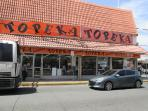 Topeka on Loiza Street, next to Walgreens, local supermarket